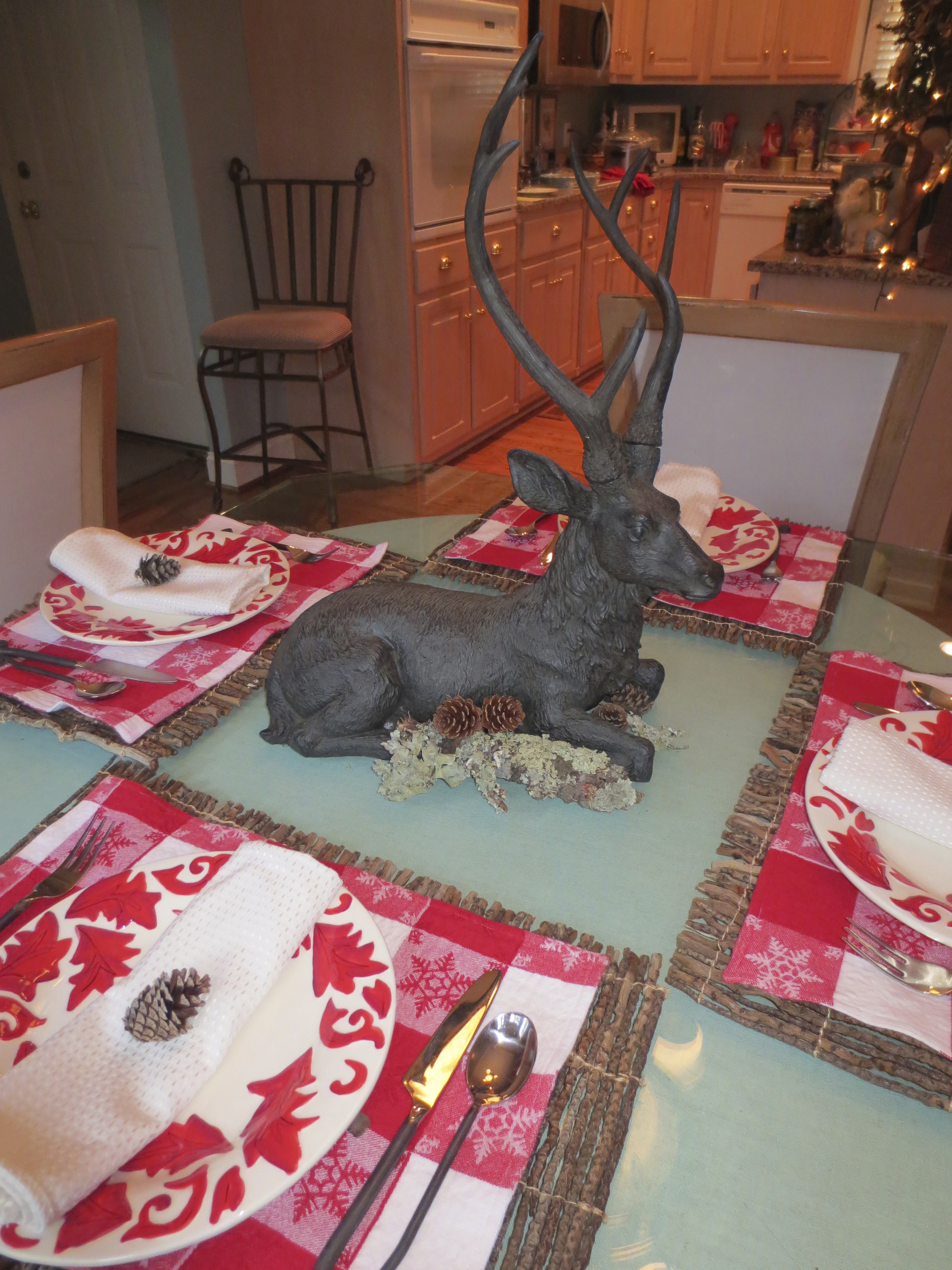 Deer, moss, and pinecone table decorations