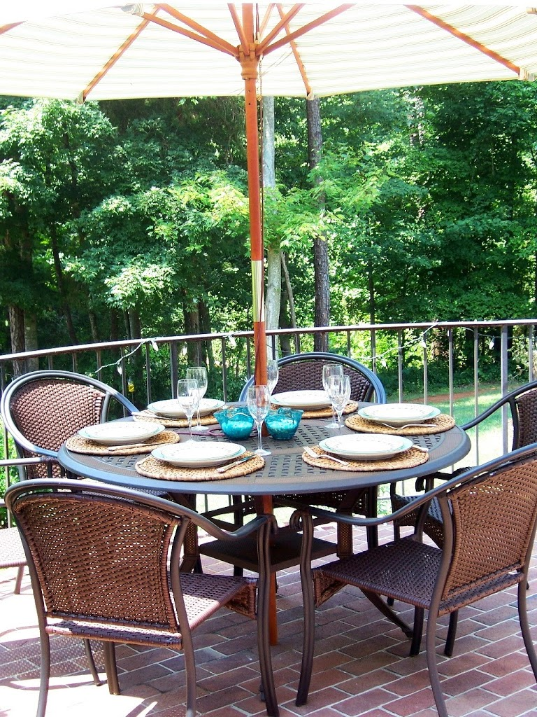 Iron and wicker patio table and chairs, combines brown and black