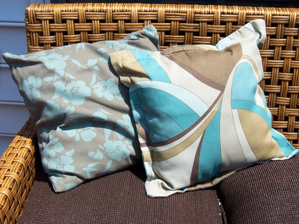 Outdoor pillows in shades of aqua and tan