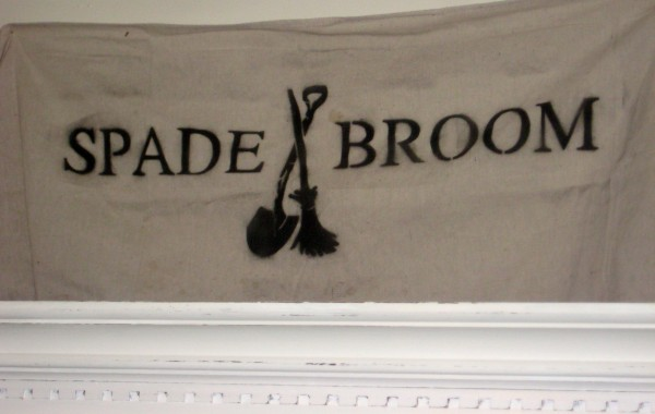 Spade and Broom Logo
