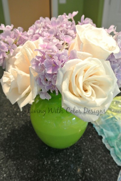 lime vase with flowers