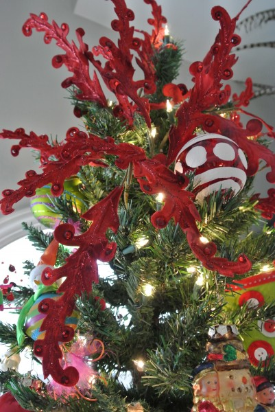 Red jeweled velvet flourishes make the perfect tree topper- Living With Color Designs