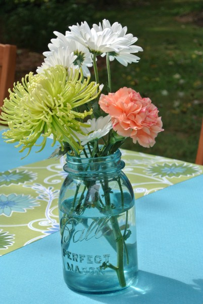 Styling an Outdoor Event- Living With Color Designs Blog- Flowers in antique ball jars decorate tables.