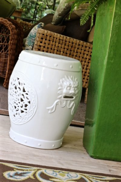 Some Things Are Worth Waiting For - styling a porch- green container and white garden seat with cut out detail