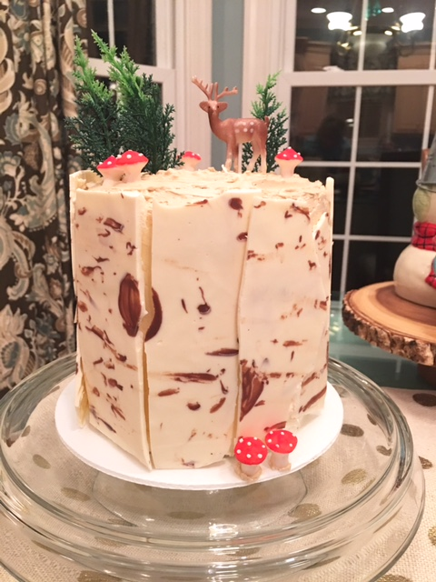Darling Birch Bark Cake- sides simulate birch logs and top is decorated with forrest scene