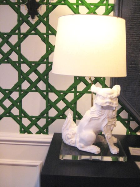 Emerald green and white wallpaper in a cane pattern with food dog lamp