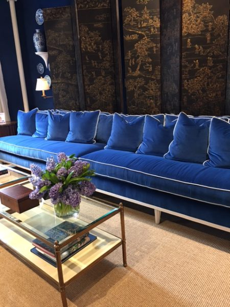 Blue velvet sofas with white trim Mark D Sikes