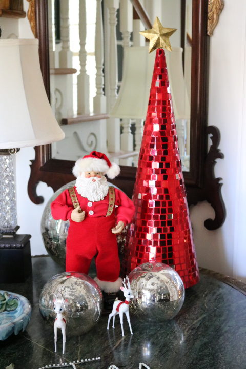 Christmas Decorating Is Easy With Cone Shaped Trees- Red mirrored cone shape tree with Santa and silver mercury balls