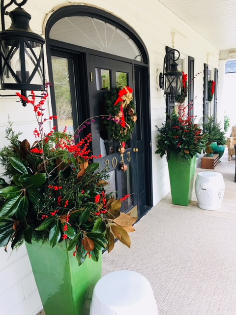 Christmas Greenery On My Southern Porch - Tall green planters with magnolia cedar and berries at front door